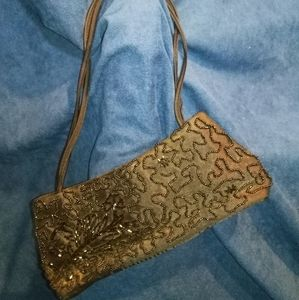 Evening purse with bead design on the front